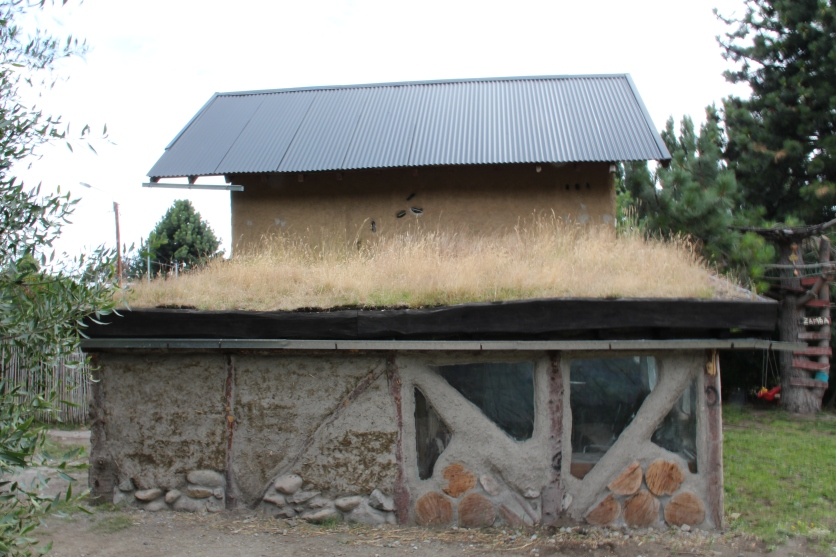 Adobe mud house with green roof
