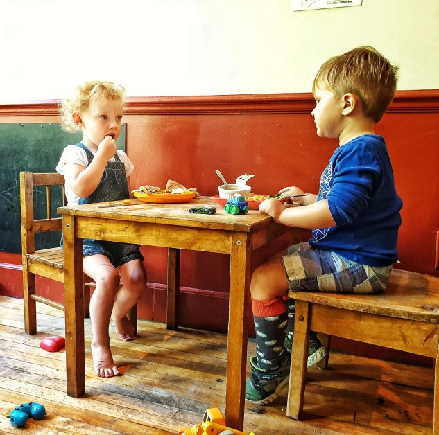 Toddlers solving the world's problems over dinner